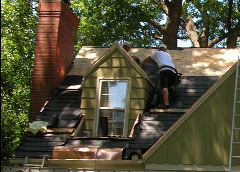 contractor installing felt interlay