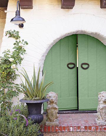 Green doors selected by designer Kathyrn Ireland for a spanish style home that was featured in House Beautiful magazine.