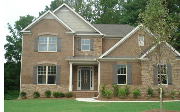 A home exterior with James Hardie siding in a neutral color that compliments the fixed features of this home