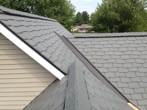 Fighting irish fan of davinci polymer slate roof for Polymer roofing shingles