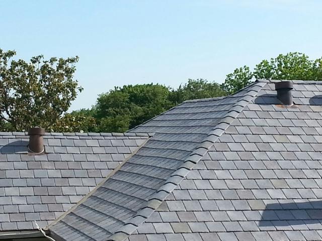 Fred flintstone 39 s boss would love davinci slate tiles for Davinci slate roof
