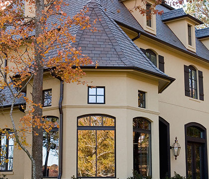 Brownstone composite roof is the right color for this stucco home