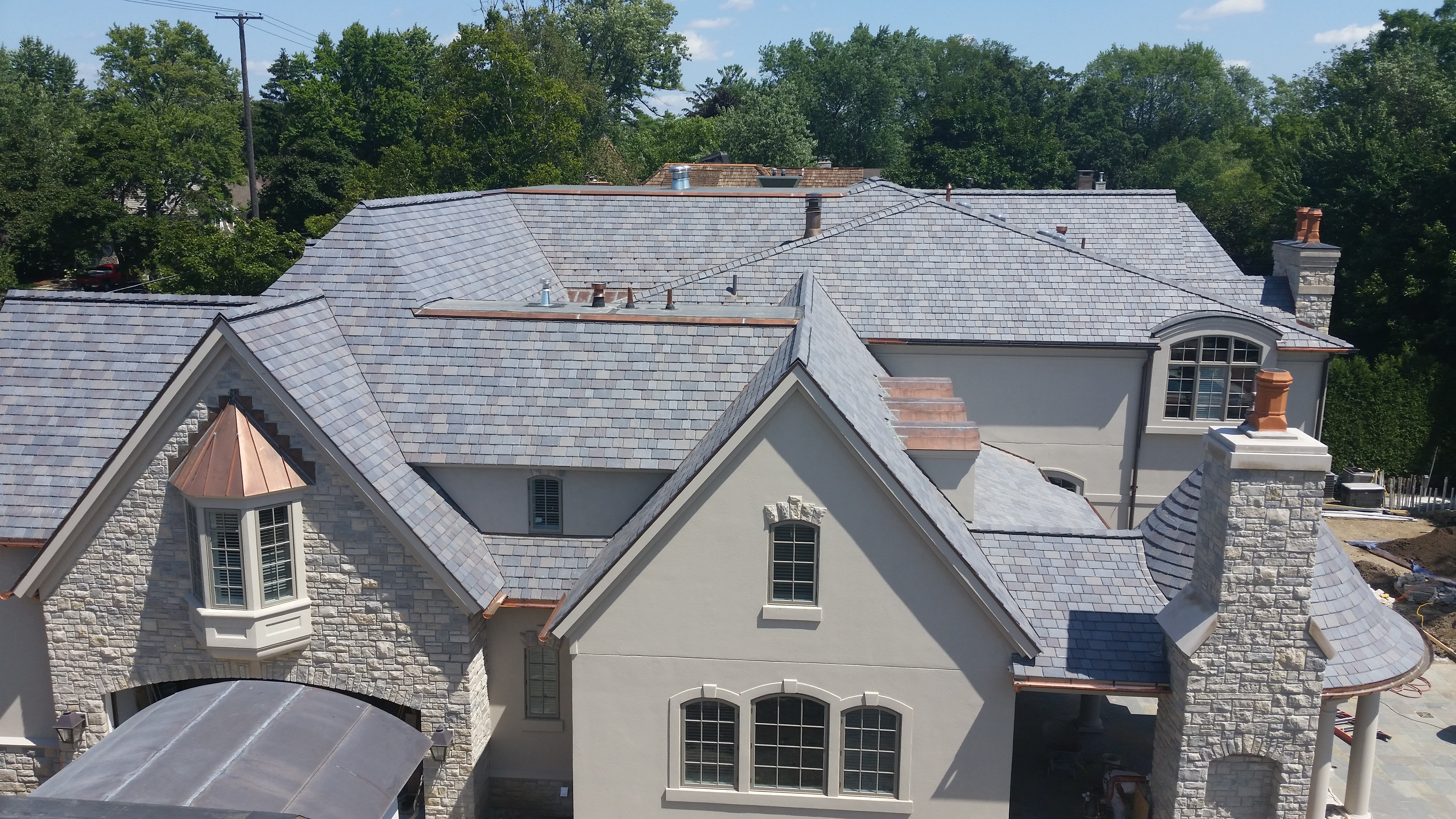 Roofers applaud lifespan looks of davinci roofs for Davinci roofscapes cost