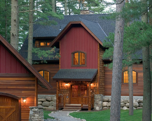 gray roof, rich red and warm wood siding on rustic home