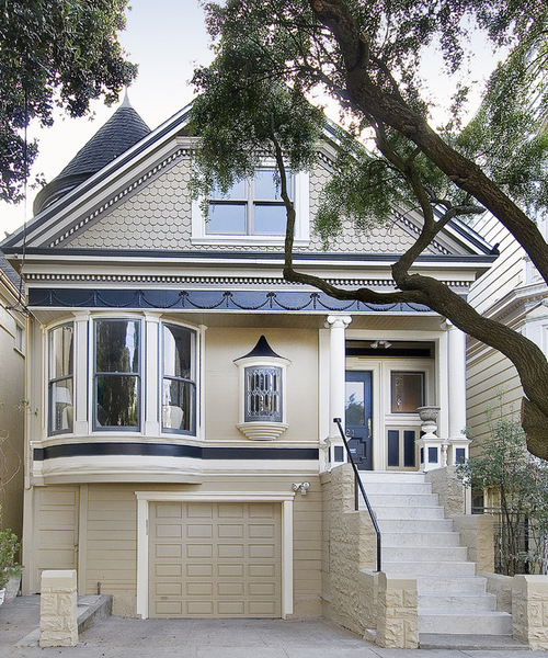 home with decorative siding and detailed molding