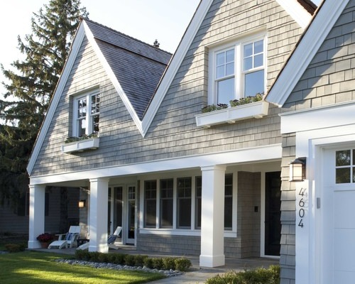 home lined with simple, classic shrubbery