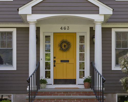 home with focal door of bright yellow