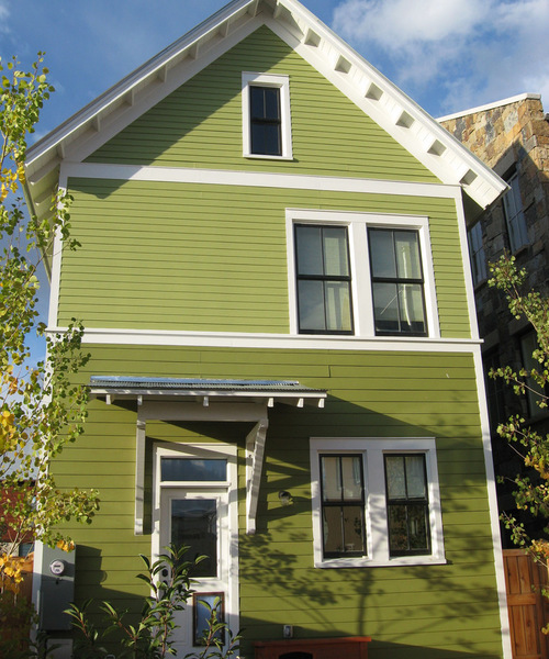 bright green hues vary from top to bottom of home exterior