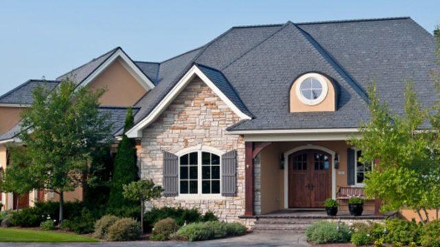 davinci slate gray roof on home with orange maple color scheme