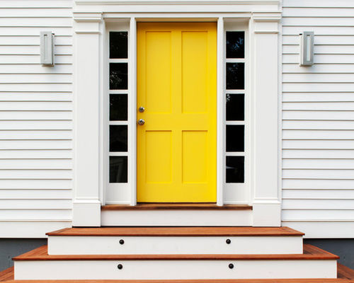 tiered stairway leading to bright yellow front exterior door
