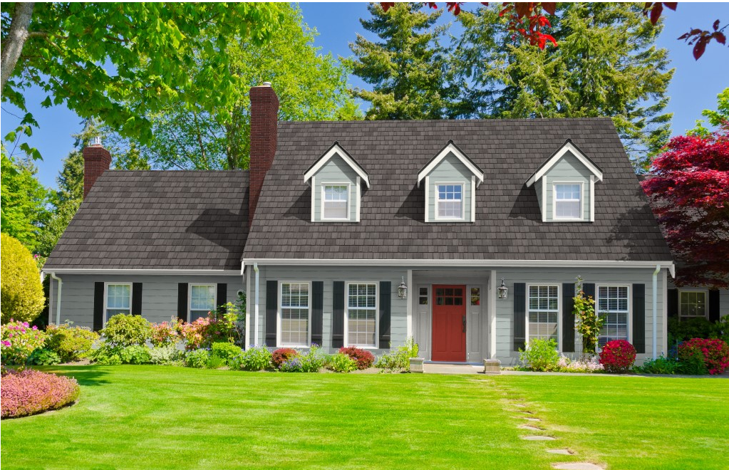 home with grey exterior black shingles red door
