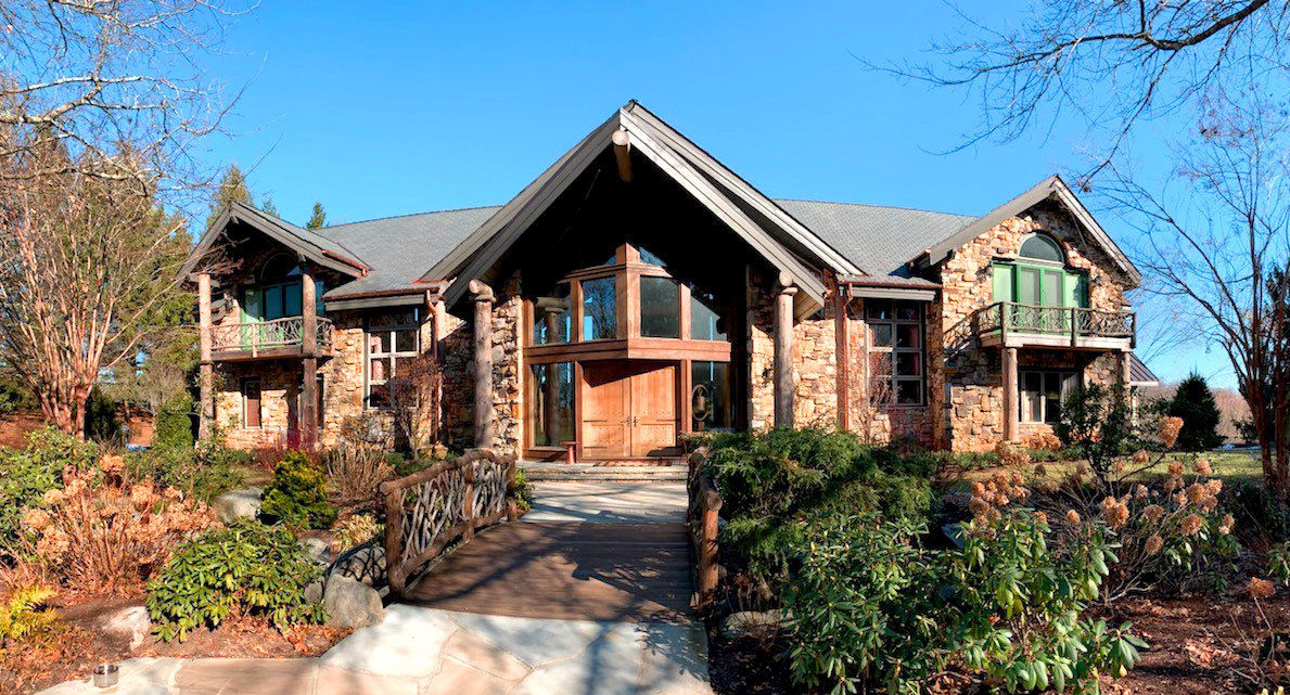 The sun sparkles off the composite roofing on this gorgeous house