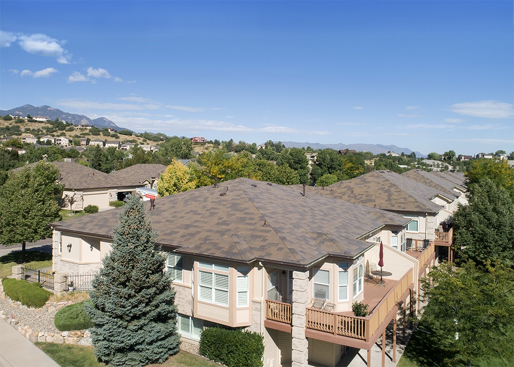 Broadmoor's worry-free DaVinci roof set against a steel-blue sky (which is also worry-free).