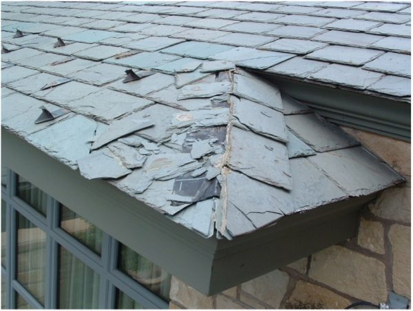 Photo of damaged slate roof tiles